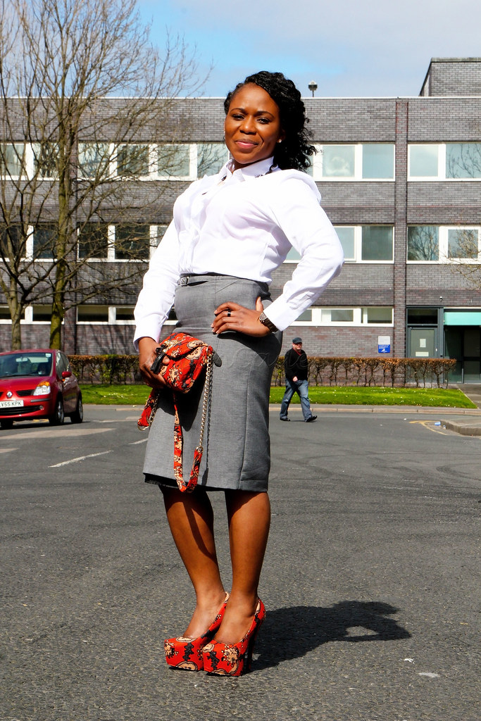 white-long-sleeved-shirt-with-a-grey-pencil-skirt-and-african-print-accessories