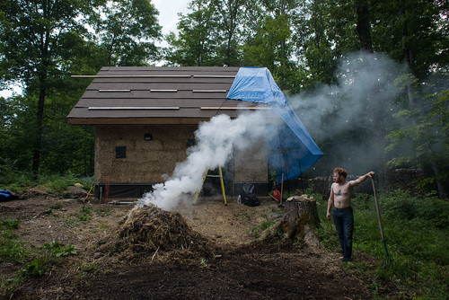 Tyler Tending Wet Straw Fire | by goingslowly