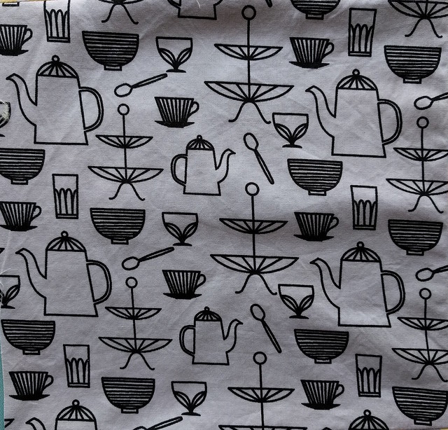 Cutlery-print fabric. The print is off grain.