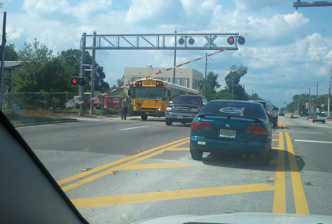 A Volusia County School Bus stuck at a RR Crossing | Flickr