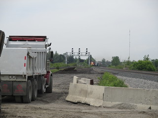 Looking west at the site of the future underpass, between the CN tracks on the left and the recently shifted GO tracks on the right. | by Metrolinx