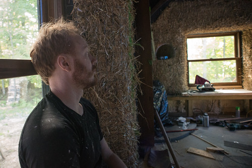 Tyler Sitting in Window Seat of Strawbale House | by goingslowly