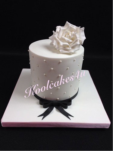 Big white rose cake with black ribbon | by Koolcakes4u