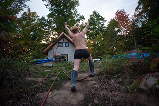 Triumphant Tyler in his Undies & Boots Climbing Rock Ridge Towards House | by goingslowly