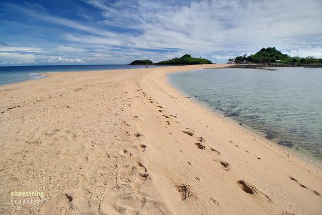 sandbar leads to Bantigue Island's rock masses