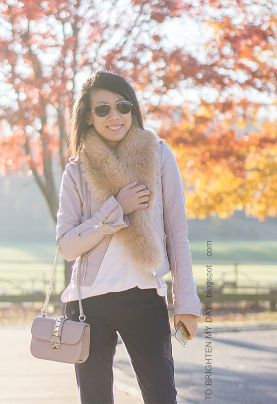 faux fur scarf, lilac pink leather jacket, light pink sweater, navy pants, nude bag