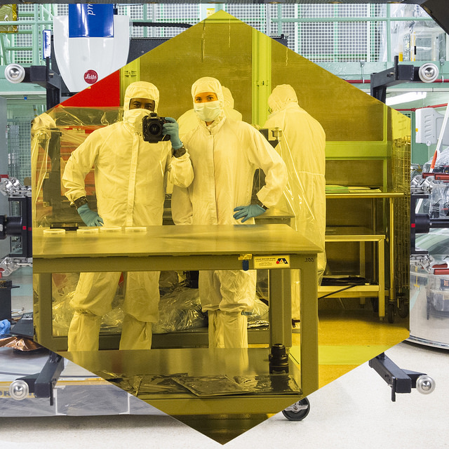 Workers posing in one of the JWST mirrors.