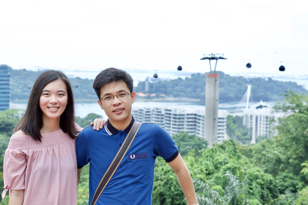 Joshua & Tiffany with cable car in the background.