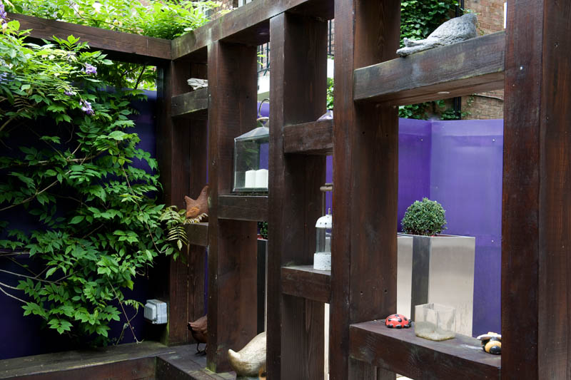 modern pergola and made from railway sleepers by earth designs garden design and build