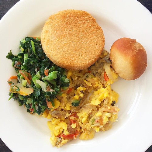 Breakfast! Johnny cake, bammy, ackee and saltfish, and steamed callaloo. #eatlovesandals #jamaica #stettedtravel #discoverydining #sandalsochi | by stetted