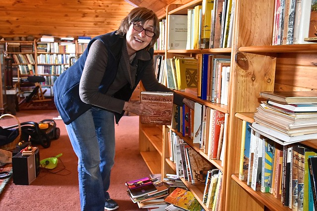 Jill rearranging books in our library - 10 October 2016