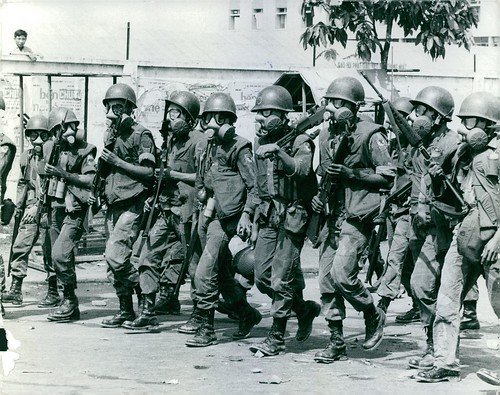 1965 Marching soldiers, wearing M17 gas mask, during Vietnam war. 2-3-65 | by manhhai