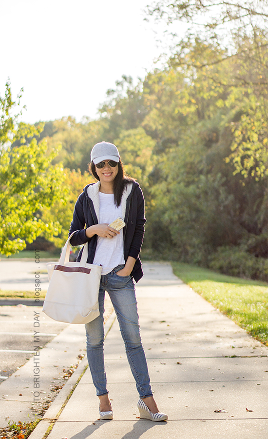 gray baseball cap, white tee, navy sherpa lined sweatshirt, lightwash skinny jeans, canvas tote, striped espadrille wedges