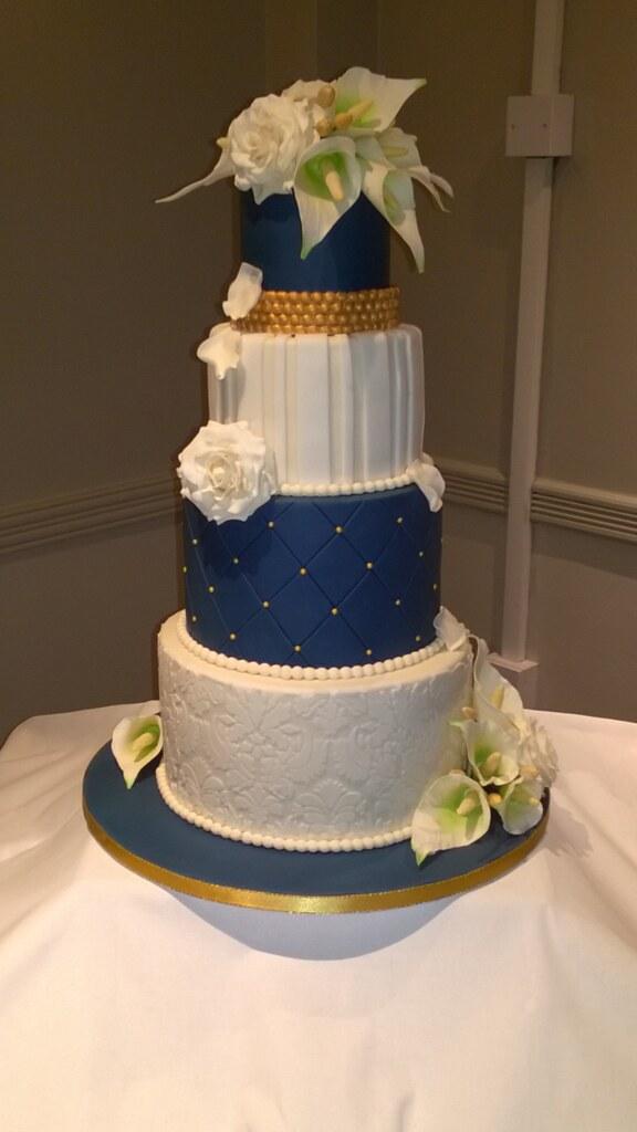 Navy, ivory & gold wedding cake with handmade sugar flower… | Flickr