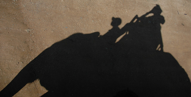 The shadow of us riding an elephant in Laos
