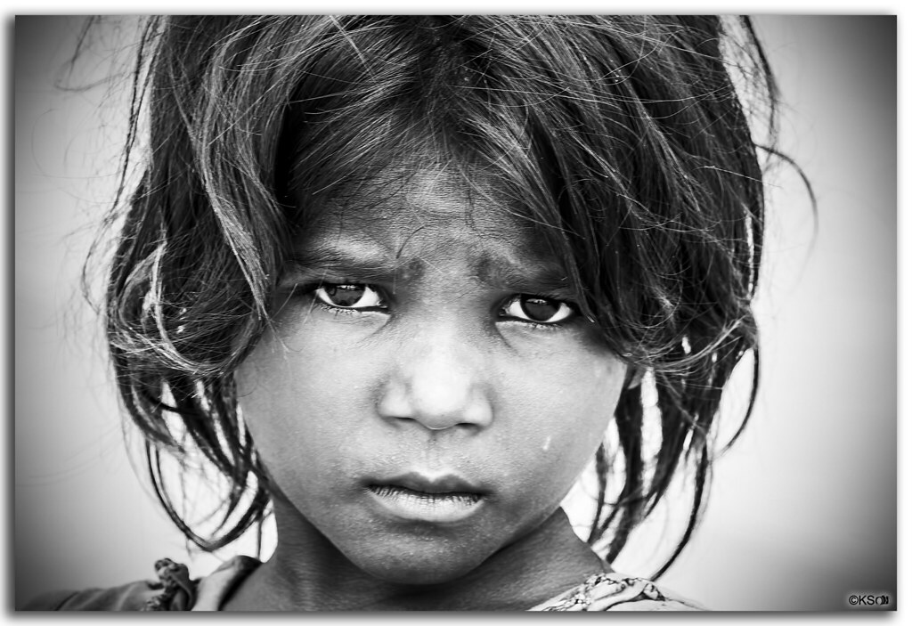 Portrait of a little indian girl lost in deep thoughts by fotographyks