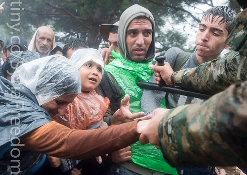 Thousands of people braved torrential downpours to cross Greece's northern border with Macedonia | by FreedomHouse
