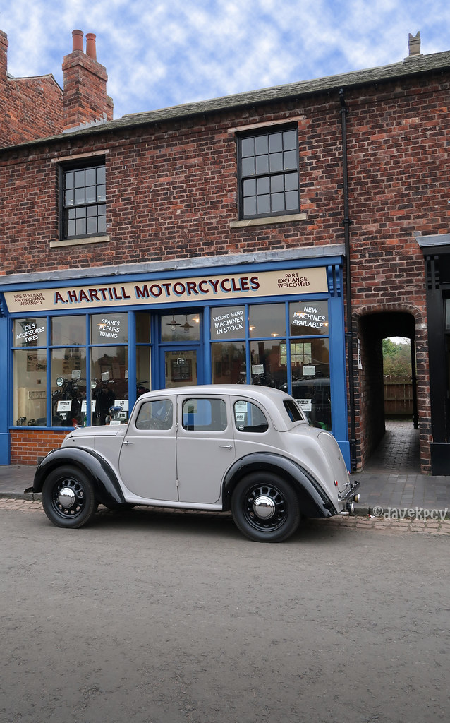 The vintage car outside the old motorcycle shop | It was jus… | Flickr
