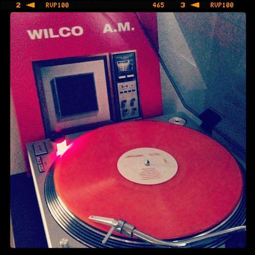 #thisonenevergetsold #nowspinning #wilco #am #firstspin #vinylmepleaseedition #orangewax #vinyloftheday #vinyligclub #photographicplaylist #vinylme #sundaysoundslikethis #coloredvinyljunkie