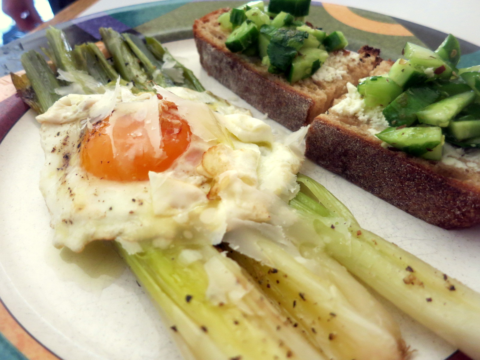 Roasted leeks, fried egg, Parmigiano-Reggiano cheese; cucumber and ricotta crostini