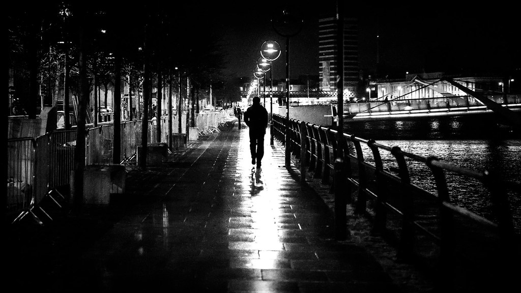Going home alone dublin ireland black and white street photography by giuseppe