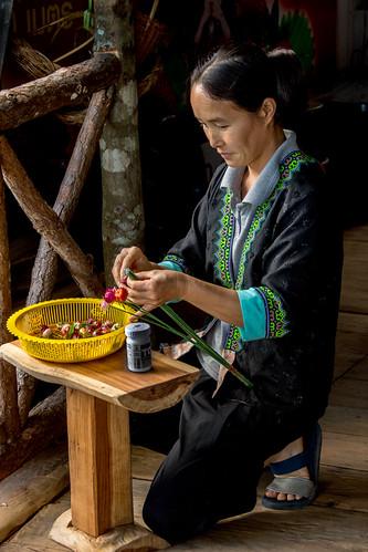 Hmong woman and homemade flowers