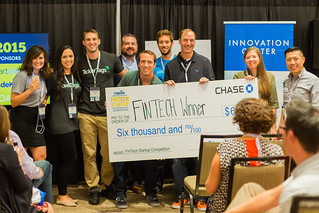 FamZoo CEO Bill Dwight (middle of check) holds first prize award for FinCon15 FinTech Startup Competition | by FamZoo