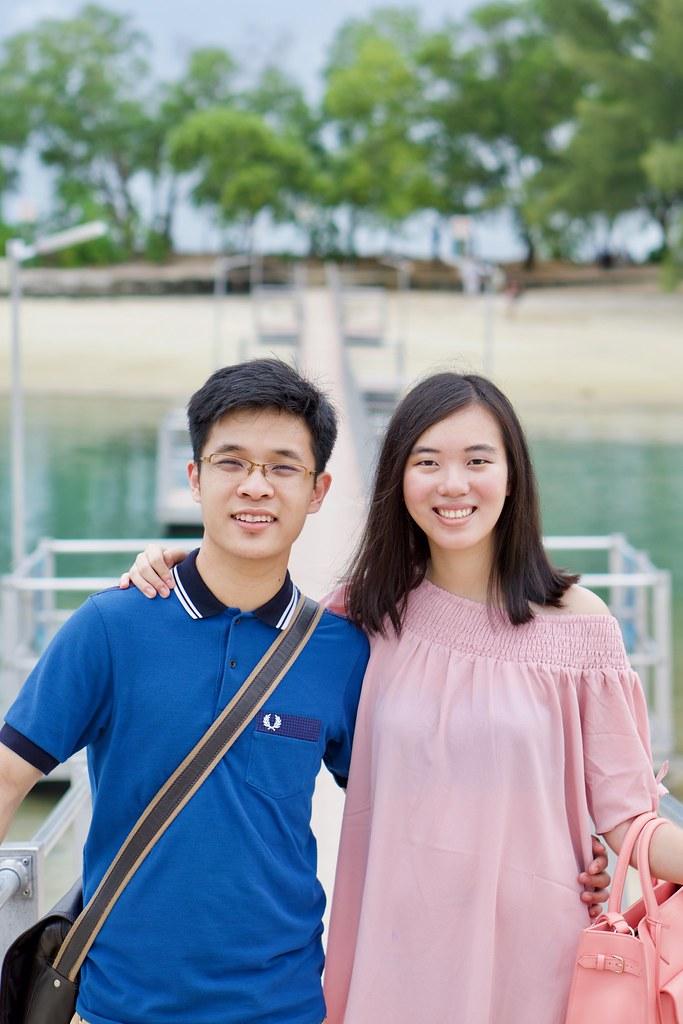 Joshua & Tiffany at a bridge.