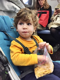 Snacking on the subway. #kidpost | by capndesign