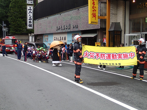 Koyasan main street Fire Fighters parade with local school children