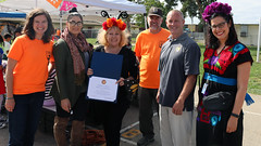 Representative Julia Brownley's Office presents Dia de los Muertos event coordinators with recognition award for their efforts to connecting children with nature.