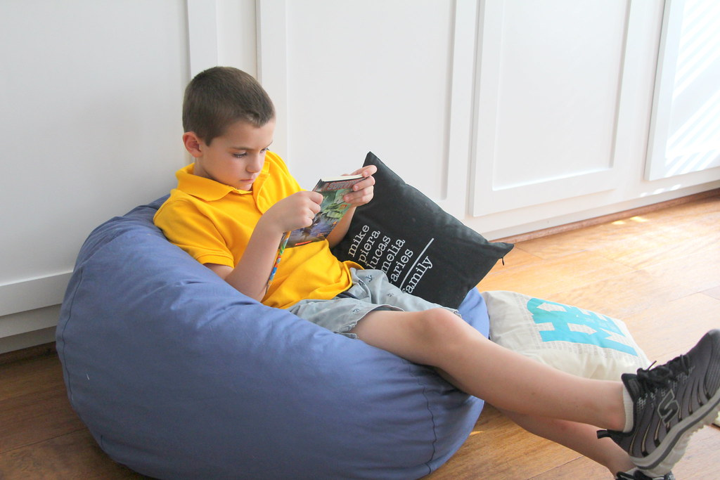 Genial ... Boy With Book On Bean Bag Chair | By PersonalCreations.com