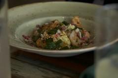 Grilled shrimp chilaquiles, bean puree, black radish, fried egg