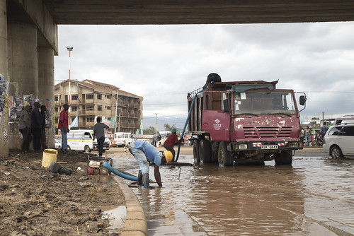 Workers Drain a Flooded Road | by World Bank Photo Collection