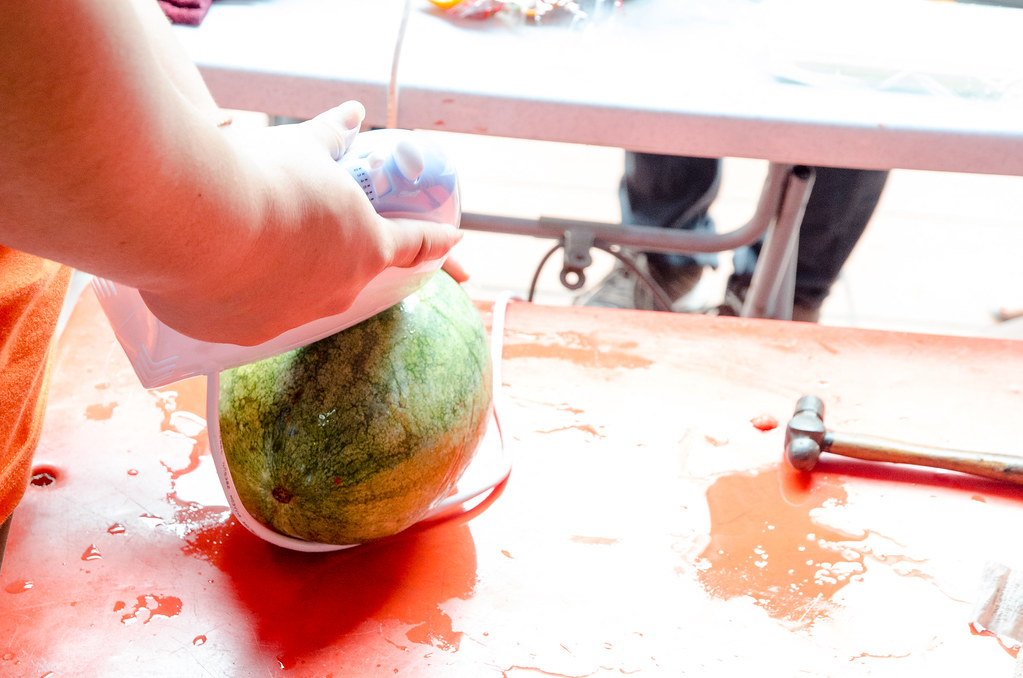 Preparing the watermelon juice in watermelon body.