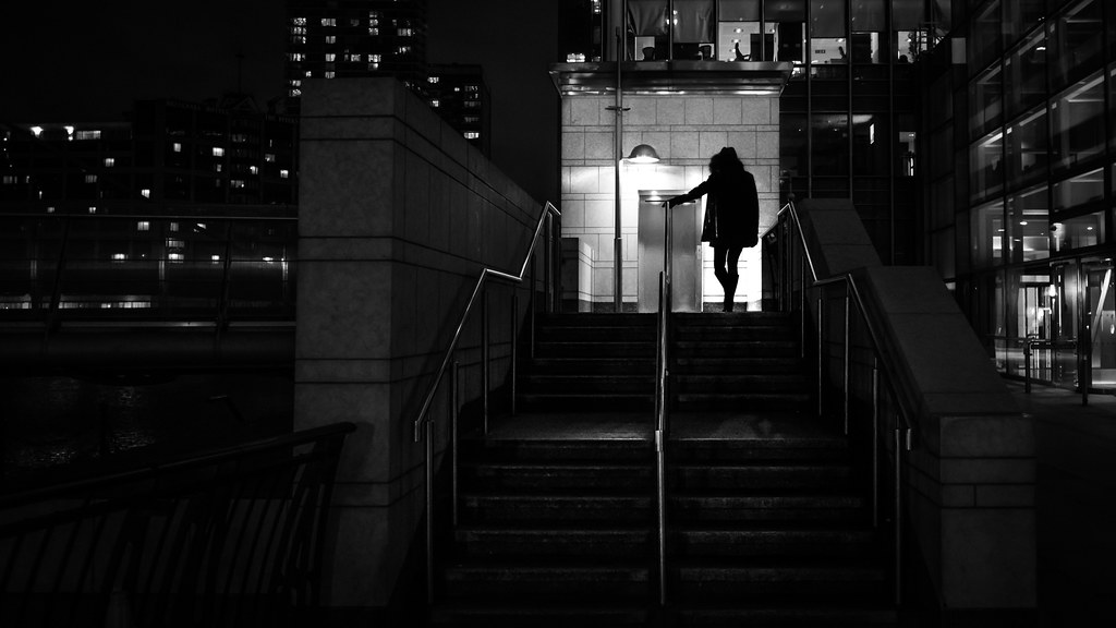 Girl going home at night london england black and white street photography