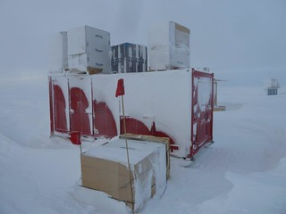 Photo of some of the bermed cargo after its first winter-over at the South Pole. | by U.S. Ice Drilling