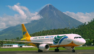 Mayon Volcano (Mount Mayon) and Cebu Pacific Air Airbus A320, view from Legazpi airport, province of Albay, Philippines | by Darius Travel Photography