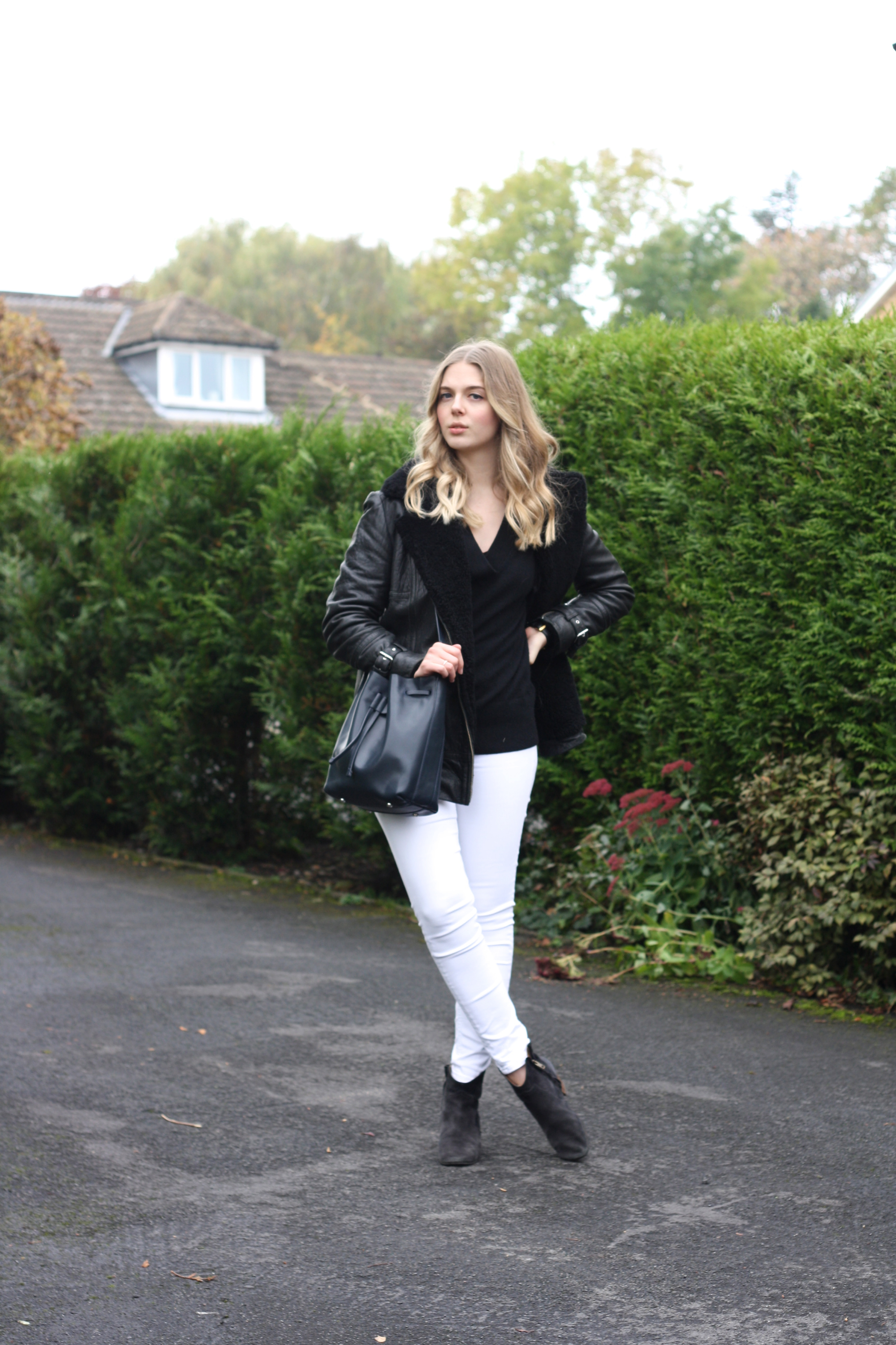 Isabel Marant Dicker boots, Whistles navy bucket bag and Topshop white skinny jeans