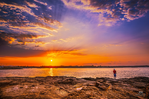 Sunrise and man fishing in Colonia de Sant Jordi, Mallorca (Spain) | by Tommie Hansen
