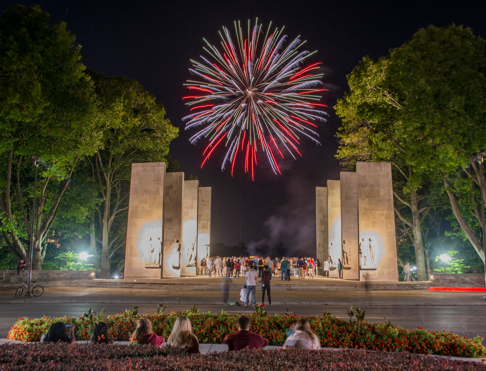 In this photo, onlookers watch from the pylons on Virginia Tech's campus as fireworks of red, white, and blue go off overhead.