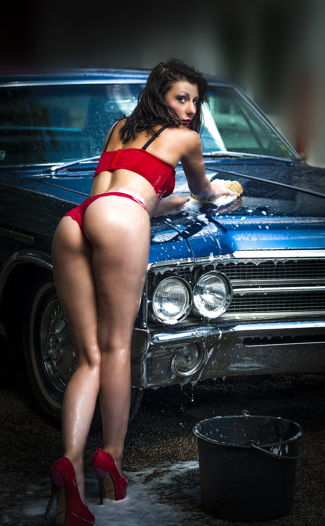 Sexy female legs in classic cars