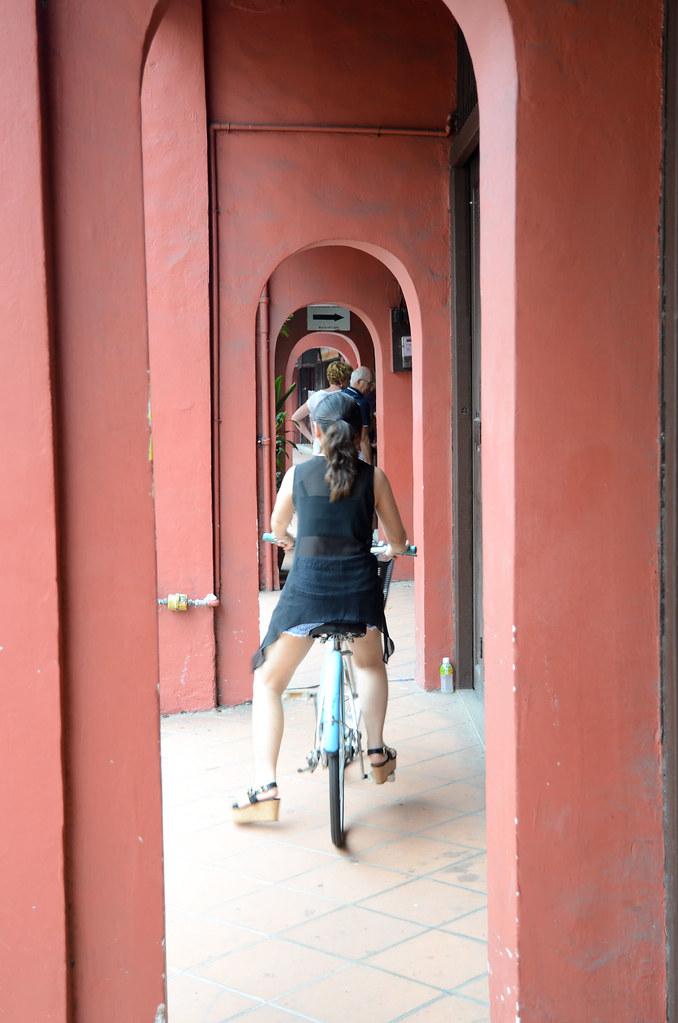 Cycling along Jonker Street of Melaka.