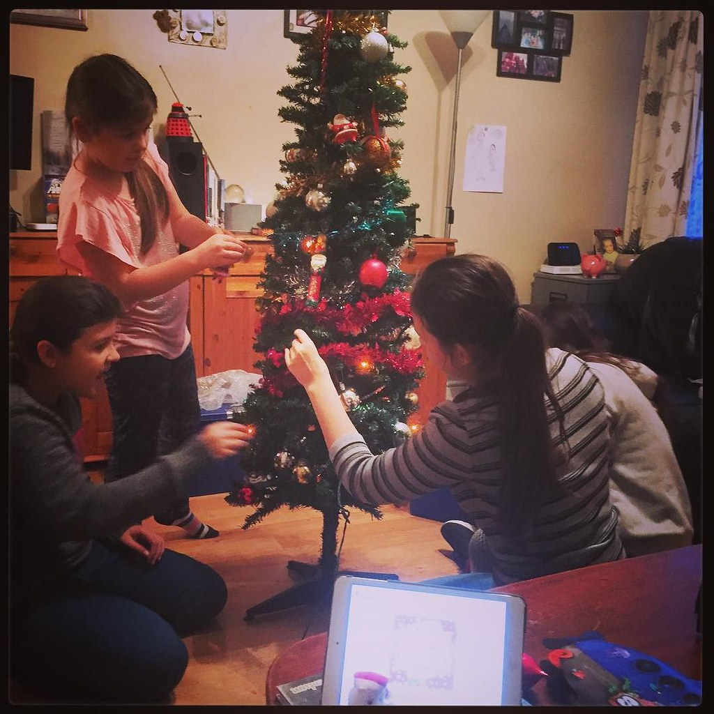 The girls decorating the tree while \