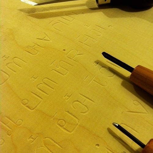 Carving Pahauh Hmong, the only script I know whose creator was assassinated for bringing his people their own writing system.