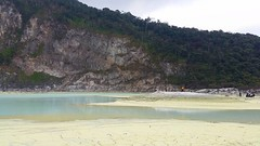 Normally with higher water levels, the current receded water line exposes  the sulfur beds of Kawah Putih, a docile volcanic crater lake located 50km south of Bandung on Mount Patuha. Being over 2,400m asl, the climate gets a little chilly.