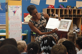 First lady Michelle Obama reads to 5 and 6-year-olds at the Naval Air Station Oceana Child and Youth Programs summer camp | by Official U.S. Navy Imagery
