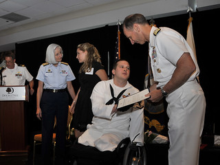 Hospital Corpsman 3rd Class James A. Raffetto and his wife are congratulated by Vice Chief of Naval Operations Adm. Jonathan W. Greenert. | by Official U.S. Navy Imagery