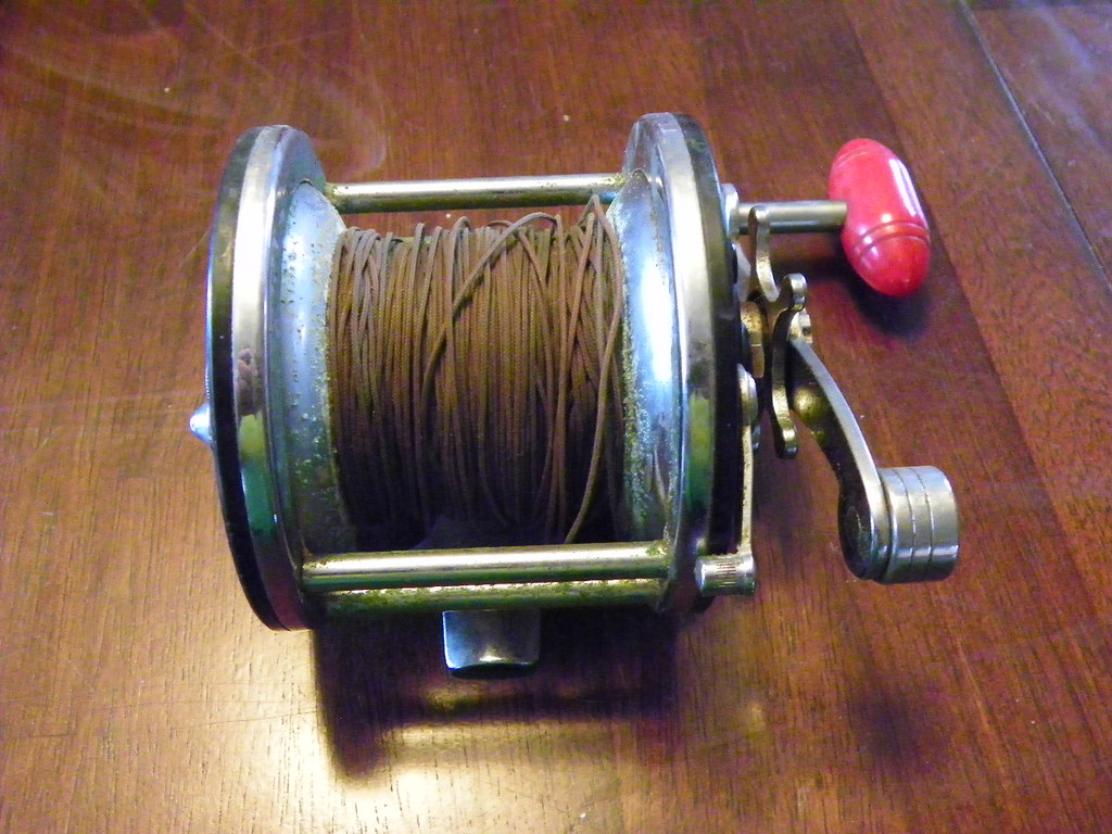 Grizzly garage sale antique fishing equipment finds flickr for Fishing gear for sale