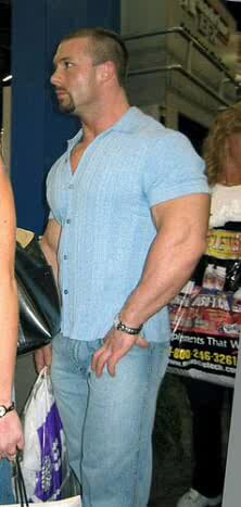 huge-bodybuilder-clay-awishes-in-tight-shirt-put-on-awesom
